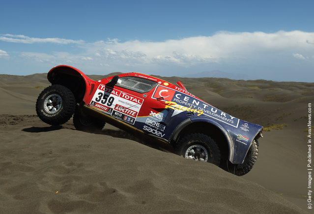Mark Corbett of South Africa drives over a sand dune during stage two of the 2012 Dakar Rally