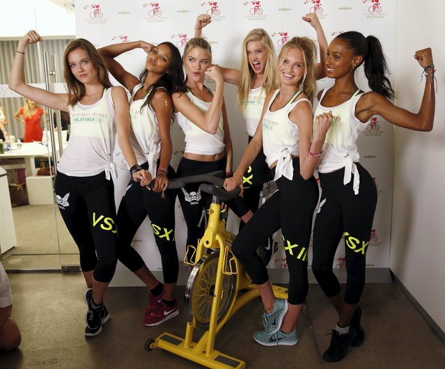 Victoria Secret Angels models (L to R) Jac Jagaciak, Lais Ribeiro, Martha Hunt, Elsa Hosk, Romee Strijd and Jasmine Tookes pose during the cycle for Pelotonia at Soul Cycle in New York July 8, 2015. Pelotonia, is annual grassroots bike tour where more than 6,000 cyclists descend upon Columbus, Ohio to ride for cancer research. (Photo by Shannon Stapleton/Reuters)