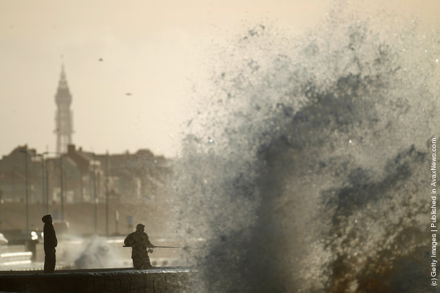 Hardy fishermen brave the wind whipped waves to fish off Blackpool promenade