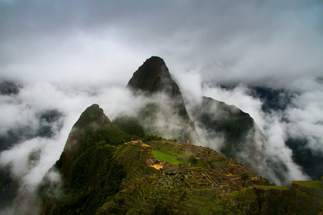 """The Lost City in the Clouds"". Even though the weather was not so good for my visit here, the clouds were swirling through the mountains quick enough to take this mystical shot of Machu Picchu. Photo location: Machu Picchu, Peru. (Photo and caption by Ben Caldwell/National Geographic Photo Contest)"
