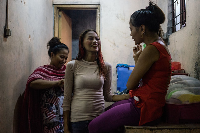 "When Gemma first started working in the red light district of Angeles City, Philippines, at 19, she was given a knife and pepper spray by her sisters. The eldest, Jojo, told her to always text the name and room number of the motel where a man would take her. Angeles City, dubbed the ""Supermarket of s*x"", thrives with foreigners, and Filipina women making money in its bars. Its streets are filled with neon lights, high heels, lingerie and loud music. The sisters never planned to come here. They were honors students in high school, and their mother described them as ""godly children"". Jojo and Gemma are among the Filipina women who have found themselves in the Philippines' s*x trade after displacement from typhoons. Haiyan hit the Philippines in 2013 and displaced about 4 million people. It was one of the strongest tropical cyclones ever recorded. A month after Typhoon Haiyan, the United Nations Population Fund estimates that 5,000 women were subjected to sexual violence. Darlene Pajarito, the head of the State Department's Philippines anti-trafficking unit, describes the wake of Typhoon Haiyan as a ""feast for human traffickers"". Here: Jojo, center, Gemma, right, and Joanne, left, get ready for a night of work in the bars in Angeles City. (Photo by Hannah Reyes Morales/The Washington Post)"