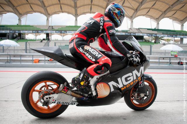 Colin Edwards of USA and NGM Mobile Forward Racing starts from box during the third day of MotoGP testing at Sepang Circuit