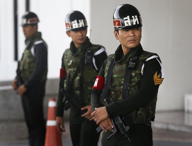 Thai soldiers stand in front of the Army Club in Bangkok May 20, 2014. Thailand's army declared martial law on Tuesday to restore order after six months of anti-government protests that have left the country without a proper functioning government, but denied that it was staging a military coup. (Photo by Athit Perawongmetha/Reuters)
