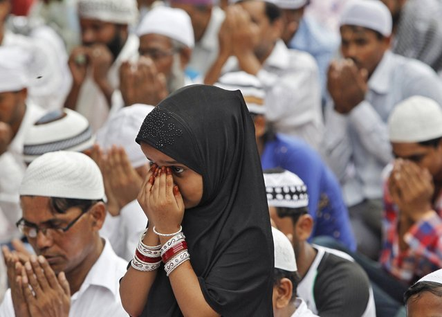 A Muslim girl offers prayers on the occasion of Eid al-Fitr in Chandigarh, India, July 18, 2015. The Eid al-Fitr festival marks the end of the holy month of Ramadan. (Photo by Ajay Verma/Reuters)