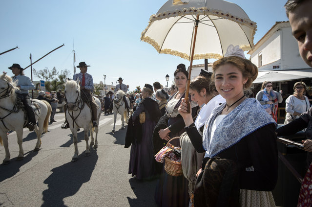 """Gypsies pictured during a procession with the sculpture of """"Sara the Black"""" to the sea on May 24, 2016 in Staintes Maries de la Mere near Arles, France. (Photo by Thomas Lohnes/Getty Images)"""