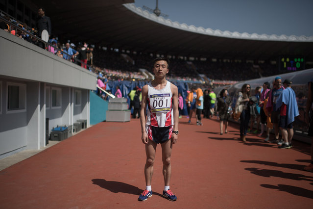 In a photo taken on April 9, 2017 marathon runner Pak Chol poses for a portrait after winning the Pyongyang Marathon, at Kim Il-Sung stadium in Pyongyang. (Photo by Ed Jones/AFP Photo)