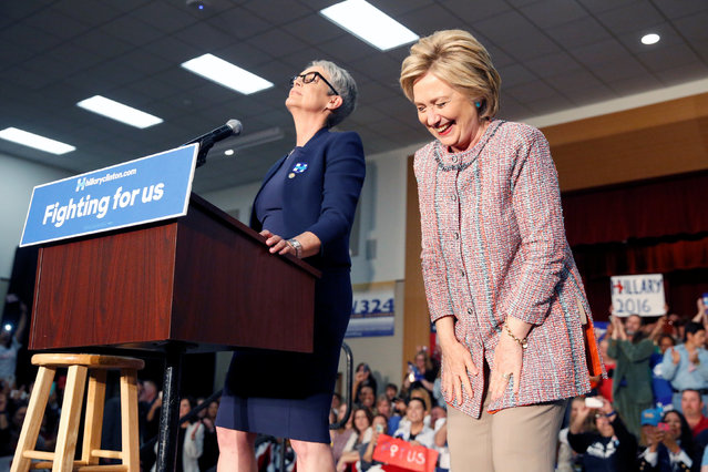 U.S. Democratic presidential candidate Hillary Clinton (R) and actress Jamie Lee Curtis react to the crowd after two male supporters took their tops off at the UFCW Union Local 324 in Buena Park, California, U.S. May 25, 2016. (Photo by Lucy Nicholson/Reuters)
