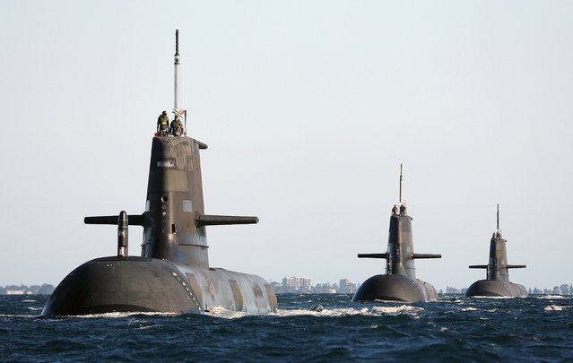 Royal Australian Navy submarines (L-R) HMAS Dechaineux, HMAS Waller and HMAS Sheean leave in formation from the Royal Australian Navy base HMAS Stirling, located near Perth, Western Australia in this picture taken on March 22, 2013, provided by the Australian Defence Force. A Japanese government team is in talks with at least two top British firms to help a Japanese consortium land one of the world's most lucrative defence contracts, sources in Tokyo said, a $50 billion project to build submarines for Australia. (Photo by Reuters/Australian Defence Force)