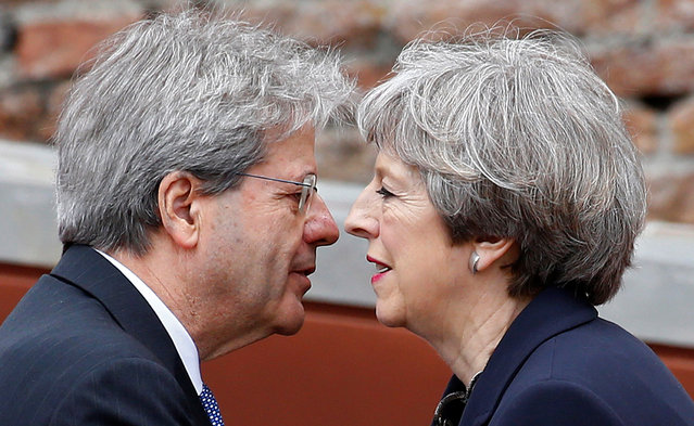 Italian Prime Minister Paolo Gentiloni and Britain's Prime Minister Theresa May attend the G7 summit in Taormina, Sicily, Italy, May 26, 2017. (Photo by Tony Gentile/Reuters)