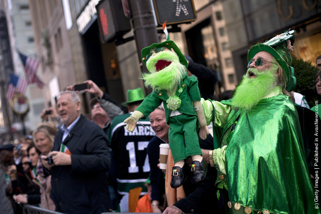 Revelers watch the 251st annual St. Patrick's Day Parade March 17, 2012 in New York City