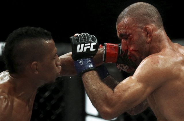Iuri Alcantara (L) of Brazil fights with Leandro Issa of Brazil during their Ultimate Fighting Championship (UFC) match, a professional mixed martial arts (MMA) competition in Rio de Janeiro, Brazil August 1, 2015. (Photo by Ricardo Moraes/Reuters)