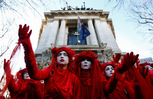 """""""Red Brigade"""" activists gesture as they participate in a demonstration against the Australian government's inaction over climate change despite the bushfires crisis, outside the Australian Embassy in London, Britain, January 10, 2020. (Photo by Henry Nicholls/Reuters)"""
