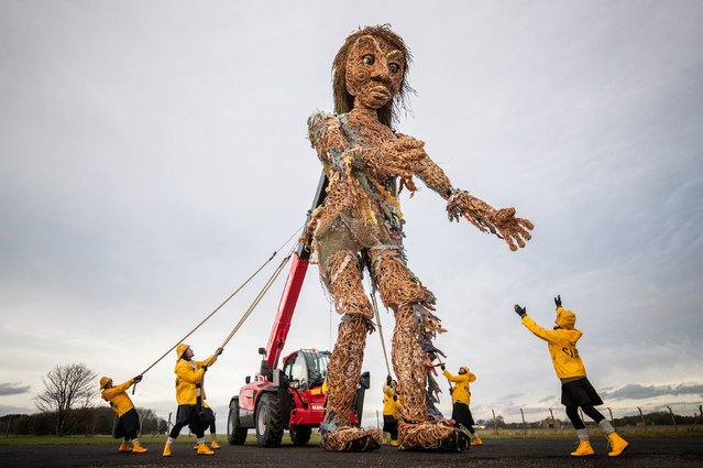 Puppeteers from Vision Mechanic rehearsing with Scotland's largest puppet, a ten-metre tall sea goddess called Storm, in the grounds of the Museum of Flight, East Lothian in Scotland on January 13, 2020. Storm, made entirely from recycled materials, was unveiled ahead of its debut at the Celtic Connections Costal Day celebrations in Glasgow this weekend. (Photo by Jane Barlow/PA Images via Getty Images)