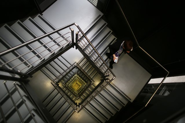 A visitor uses a staircase at the British Museum's new World Conservation and Exhibitions Centre on July 11, 2014 in London, England. The new £135 million building extends 20 meters underground and contains new storage and conservation spaces. (Photo by Peter Macdiarmid/Getty Images)
