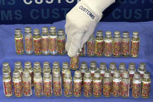 """Some of the 150 bottles containing illegal liquid steroids hidden inside sexual lubricant packaging seized by the Australian Customs is seen in this handout obtained July 30, 2008. Customs said that the bottles, labelled as """"gay lube oil"""", actually contained prohibited performance and image enhancing drugs manufactured and sent from Thailand. (Photo by Reuters/Australian Customs)"""