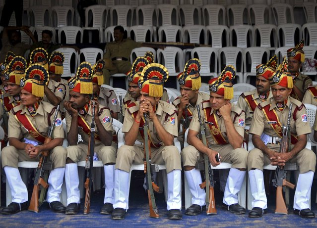 India's Railway Protection Force (RPF) personnel sit after they participated in the full-dress rehearsal for India's Independence Day celebrations in Bengaluru, India, August 13, 2015. (Photo by Abhishek N. Chinnappa/Reuters)