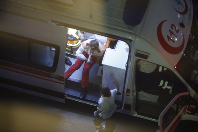 An injured person sits in an ambulance outside Istanbul's Ataturk airport, Tuesday, June 28, 2016. (Photo by Emrah Gurel/AP Photo)