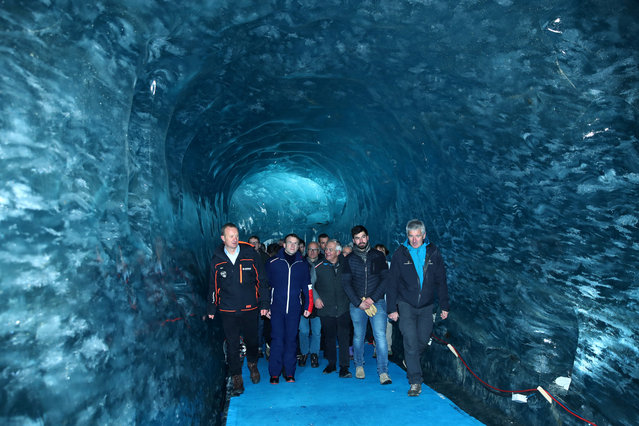 """French President Emmanuel Macron, accompanied by Compagnie du Mont-Blanc CEO Mathieu Dechavanne and glaciologist Luc Moreau, visits the """"Mer de Glace"""", France's largest glacier, which has shrunk dramatically in recent years, in Chamonix, France on February 13, 2020. (Photo by Denis Balibouse/Pool via Reuters)"""