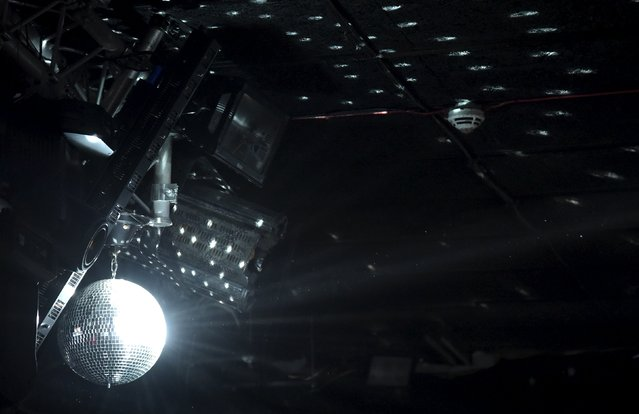 """A glitterball is seen hanging from the ceiling at """"Morning Gloryville"""" at the Ministry of Sound in south London August 11, 2015. (Photo by Toby Melville/Reuters)"""