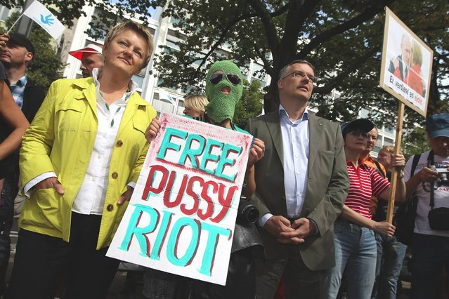 Renate Kuenast (L) of the German Greens Party and Markus Loening, German Federal Human Rights Commissioner, join supporters of the Russian female punk band p*ssy Riot protesting outside the Russian embassy on August 17, 2012 in Berlin, Germany. A Moscow court is scheduled to announce a verdict in the trial of the three musicians later today in a case that has attracted global attention over the issues of freedom of speech and artistic expression in modern Russia. (Photo by Sean Gallup)
