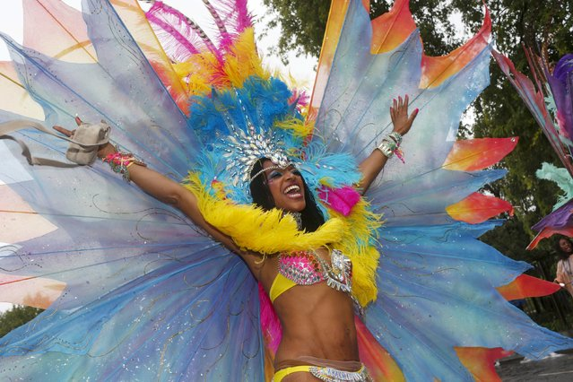 A performer poses for a photograph at the Notting Hill Carnival in west London, August 31, 2015. (Photo by Eddie Keogh/Reuters)