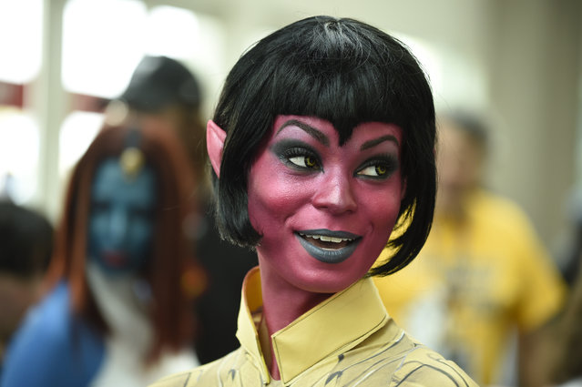 Sara Moni, dressed as the World of Warcraft's Sinestra, poses for photographers on day three of the Comic-Con International held at the San Diego Convention Center Saturday July 23, 2016 in San Diego.  (Photo by Denis Poroy/Invision/AP Photo)