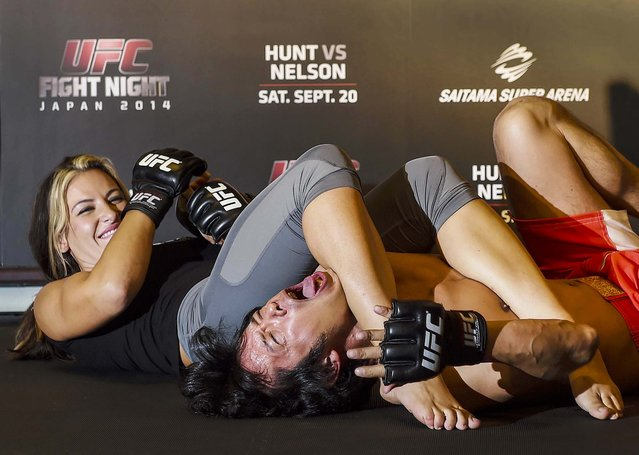 Miesha Tate, UFC women's bantaweight shows the media how to fight during a UFC press conference at Akasaka Garden City on August 26, 2014 in Tokyo, Japan. (Photo by Atsushi Tomura/Getty Images)