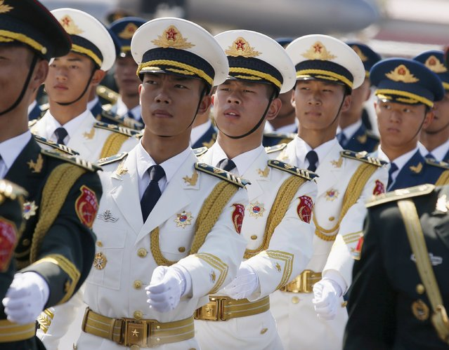 Honour guards make their way as they prepare for foreign leaders' arrivals at Beijing Capital International Airport in Beijing, China, September 2, 2015, ahead of the commemoration of the 70th anniversary of the end of World War Two. (Photo by Kim Kyung-Hoon/Reuters)