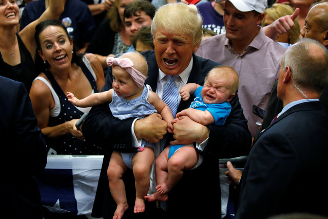 Republican presidential nominee Donald Trump holds babies at a campaign rally in Colorado Springs, Colorado, U.S., July 29, 2016. (Photo by Carlo Allegri/Reuters)