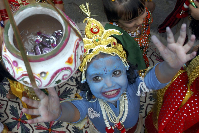 "A child dressed as Lord Krishna participates in a fancy dress competition ahead of ""Janamashtmi"" celebrations in Shimla, capital of Himachal Pradesh August 22, 2008. (Photo by Anil Dayal/Reuters)"