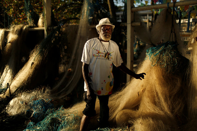 """Jose de Jesus Damaceno, a 75-year-old fisherman, poses for a portrait in Rio de Janeiro, Brazil, July 13, 2016. When asked what he felt about Rio de Janeiro hosting the Olympics, Jose de Jesus said, """"The city is in crisis and there is no opportunity for anyone, the government should take more care of the population before spending money on an event like this"""". (Photo by Pilar Olivares/Reuters)"""
