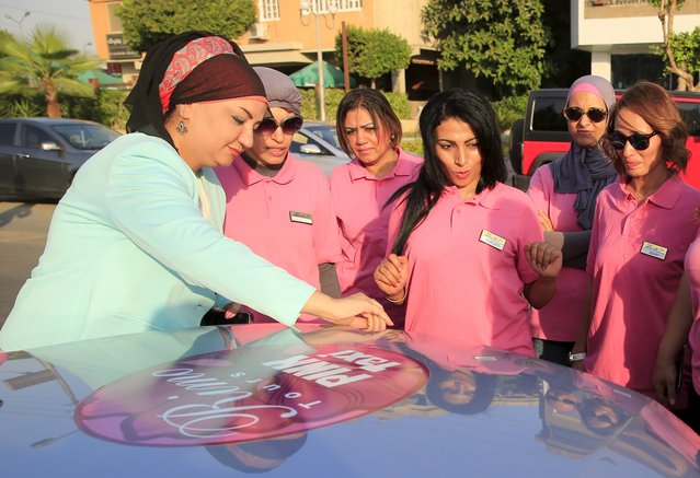 Reem Fawzy (L), the director of the Pink Taxi company, stands with her drivers in a parking lot in Cairo, Egypt, September 6, 2015. (Photo by Amr Abdallah Dalsh/Reuters)