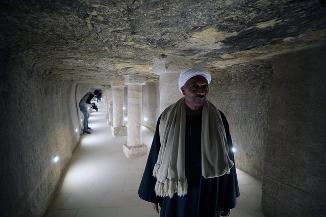 A worker stands inside the entrance to the Burial Chamber inside King Djoser's step pyramid, also known as the Saqqara pyramid, in Saqqara area, Giza, Egypt, 05 March 2020.Egypt on 05 March 2020 reopened the Djoser Pyramid after a restoration project that initially began in 2006, before it was halted in 2011 and resumed in 2013. The project included restoration of the outer facades of the pyramid, the internal corridors leading to the burial well, the stone sarcophagus, and stairs of two entrances. The King Djoser's step pyramid is the main attraction at the Saqqara necropolis that includes also tens of tombs, royal pyramids and noblemen tombs and a Middle Kingdom pyramid. (Photo by Khaled Elfiqi/EPA/EFE)