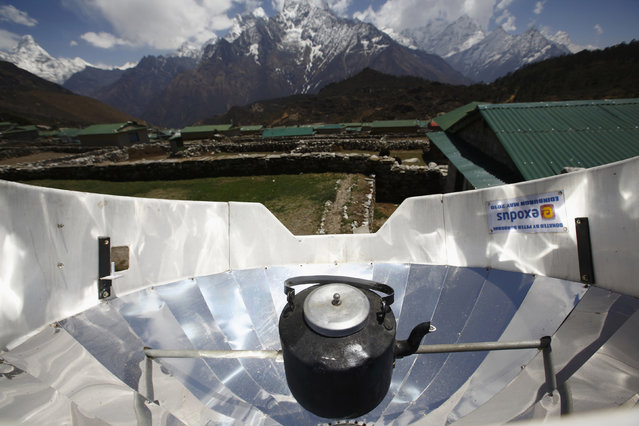 Water is boiled using solar power in Khumjung, in Solukhumbu District April 30, 2014. (Photo by Navesh Chitrakar/Reuters)