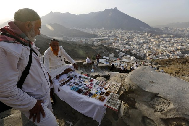 A vendor sells prayer beads on Mount Al-Noor, where Muslims believe Prophet Mohammad received the first words of the Koran through Gabriel in the Hera cave, during the annual Haj pilgrimage in the holy city of Mecca September 30, 2014. (Photo by Muhammad Hamed/Reuters)
