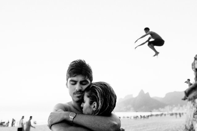 """David Alan Harvey's shots of Rio and Bahia, taken over the course of a decade, look beyond the cliches of bikini babes, crime-ridden favelas and Christ the Redeemer. Here: Rio de Janeiro, Ipanema beach. David Alan Harvey, founder of Burn magazine and a member of Magnum, has spent 10 years photographing the wild vitality and natural beauty of Bahia and Rio. He describes each of his images: """"Wilson Crispim, a parkour artist, had just made about eight super jumps for me. He said he was exhausted. I told him fine, so I was just shooting my friends on the beach. Out of the corner of my eye I saw Wilson running to make another jump. I've learned that things are never over until they are really, really over"""". (Photo by David Alan Harvey/The Guardian)"""