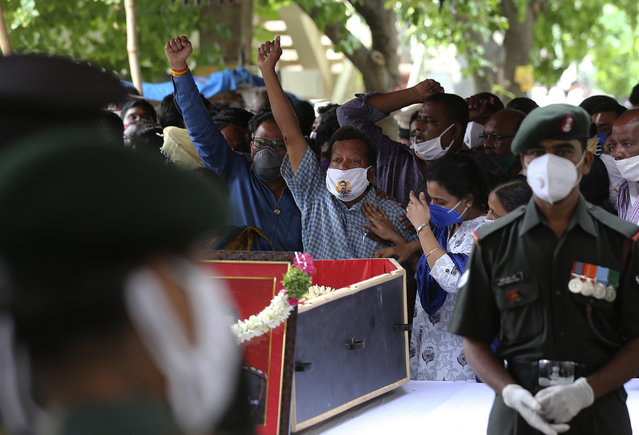 "People gathered shout slogans during the funeral of Colonel B. Santosh Babu in Suryapet, about 140 kilometers from Hyderabad, India, Thursday, June 18, 2020. Babu was among the twenty Indian troops who were killed in the clash Monday night that was the deadliest conflict between the sides in 45 years. India on Thursday cautioned China against making ""exaggerated and untenable claims"" to the Galvan Valley area even as both nations tried to end a standoff in the high Himalayan region where their armies engaged in a deadly clash. (Photo by Mahesh Kumar A./AP Photo)"