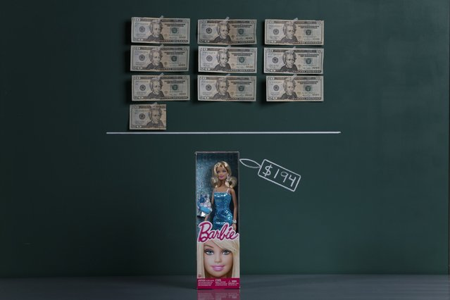 A Barbie doll as photographed in a studio with an illustrative price tag of $194 (US dollars), equivalent to the Bs. 1,226 (bolivars) that it costs on average to purchase in Caracas at the official exchange rate of 6.3 bolivars per dollar, in Caracas September 29, 2014. (Photo by Carlos Garcia Rawlins/Reuters)