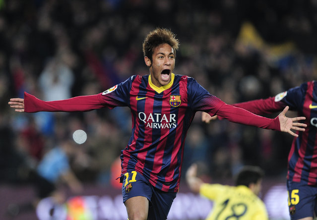 Barcelona's Brazilian forward Neymar da Silva Santos Junior (L) celebrates his second goal during the Spanish league football match FC Barcelona vs Villarreal CF at the Camp Nou stadium in Barcelona on December 14, 2013.   AFP PHOTO/ JOSEP LAGO        (Photo credit should read JOSEP LAGO/AFP/Getty Images)