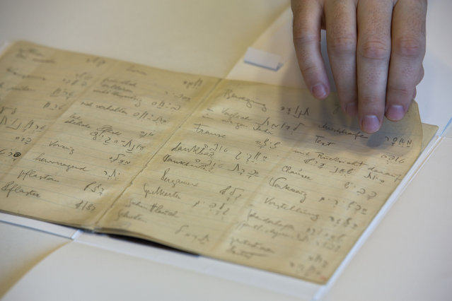 In this photo taken Sunday, October 5, 2014, a library official shows celebrated author Franz Kafka's Hebrew vocabulary notebook at Israel's National Library in Jerusalem. (Photo by Sebastian Scheiner/AP Photo)