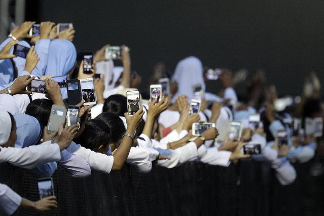 Nuns prepare their devices to film Pope Francis before he arrives for a meeting with the bishops of Myanmar at St. Mary's Cathedral in Yangon on November 29, 2017. Pope Francis spread a message of forgiveness in a historic open-air mass before a sea of worshippers in Yangon on on November 29, during a visit to conflict-torn Myanmar that has been framed so far by his public sidestepping of the Rohingya crisis. (Photo by Andrew Medichini/AFP Photo)