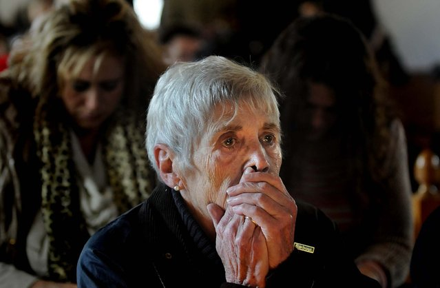 Lee Paulsen listens to a healing service held at St. John's Episcopal Church in Newtown. (Photo by Cloe Poisson/Hartford Courant/MCT)