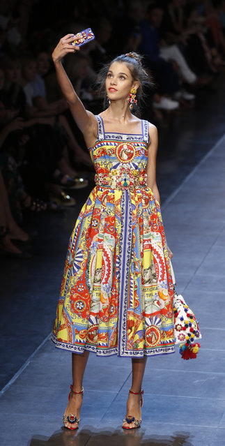 A model wears a creation for Dolce&Gabbana women's Spring-Summer 2016 collection, part of the Milan Fashion Week, unveiled in Milan, Italy, Sunday, September 27, 2015. (Photo by Luca Bruno/AP Photo)