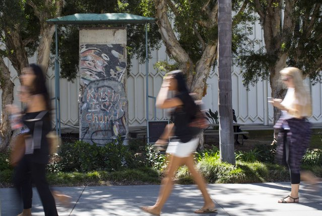A segment of the Berlin Wall is seen on the main campus of Loyola Marymount University in Los Angeles, California September 18, 2014. (Photo by Mario Anzuoni/Reuters)