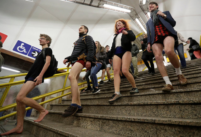 """Passengers not wearing pants walk down the stairs during an annual flash mob event called the """"No Pants Subway Ride"""" in Prague, Czech Republic on January 7, 2018. (Photo by David W. Cerny/Reuters)"""