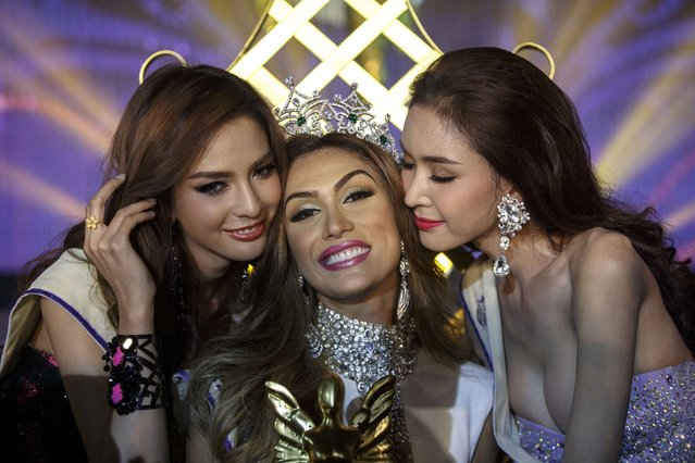 Isabella Santiago of Venezuela (C) is kissed by runner-ups after she was crowned Miss International Queen 2014 at the transgender/transsexual beauty pageant in Pattaya November 7, 2014. (Photo by Athit Perawongmetha/Reuters)