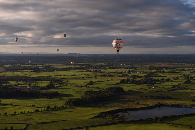 Hot air balloons fly during the Irish hot air ballooning championships in Galway, Ireland September 26, 2016. (Photo by Clodagh Kilcoyne/Reuters)