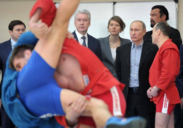 Russian President Vladimir Putin, second right, and U.S. movie actor Steven Seagal, right rear, visit  a new sports arena in Moscow, Wednesday, March 13, 2013. President Vladimir Putin has called for the revival of the Soviet-era physical evaluation program that required all schoolchildren to pass fitness tests. In center is Moscow mayor Sergei Sobyanin. (Photo by Alexei Nikolsky/AP Photo/RIA Novosti/Presidential Press Service)