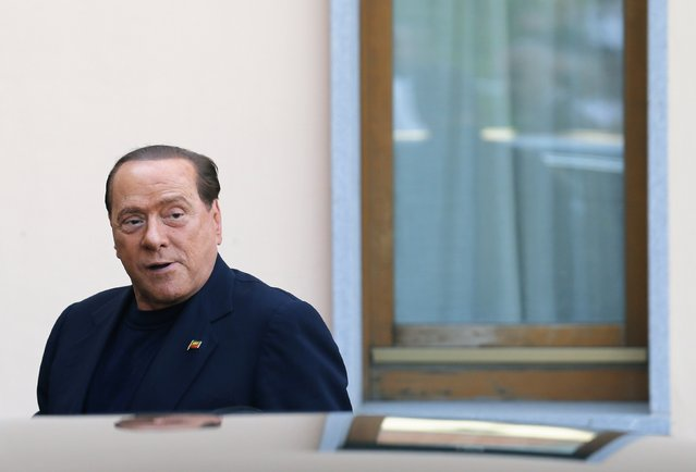 Former Italian prime minister Silvio Berlusconi looks on as he arrives at the Sacred Family Foundation, where he will serve part of his one-year tax fraud sentence by doing community service with the elderly, in Cesano Boscone, a small town on the outskirts of Milan, in this May 9, 2014 file photo. (Photo by Stefano Rellandini/Reuters)