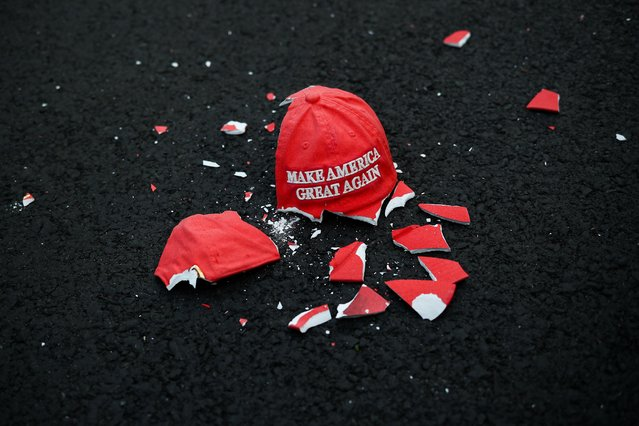 "A broken ""Make America Great Again"" hat model lies on the ground as people gather at Black Lives Matter Plaza in Washington, U.S. November 3, 2020. (Photo by Hannah McKay/Reuters)"